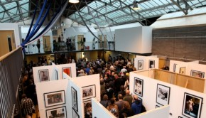 Image depicts a busy exhibition at the Out of the Blue Drill Hall
