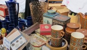 Various ornaments line the tables of the Edinburgh Flea Market, including cups, vases and jugs.