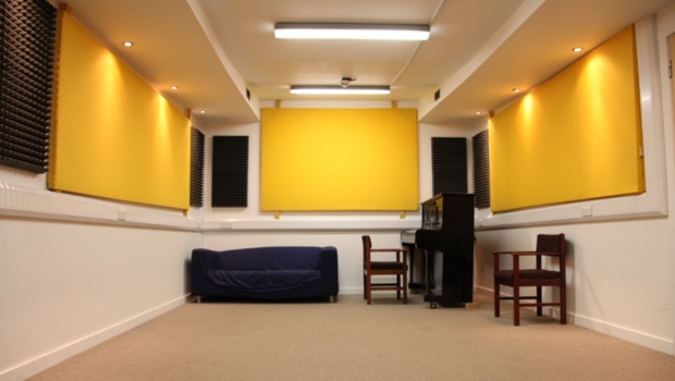The Music Room space hire, fully equipped with a piano and couch.