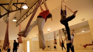 Aerialists in the Rehearsal Room practising acrobatics for an upcoming theatre performance.