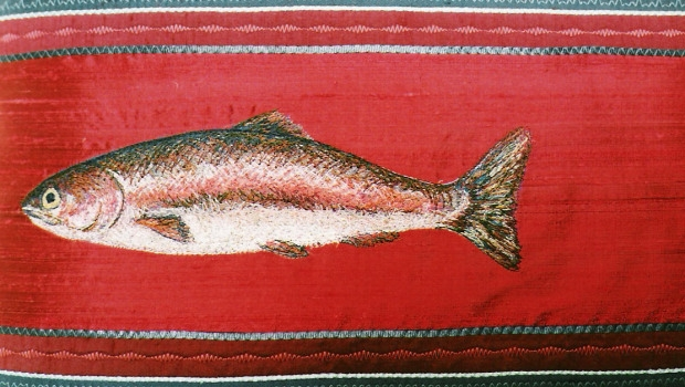 Embroidered fish on red material