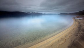 Photograph of a beach at a lakeside, by Ian Preece