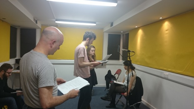 Young Actors rehearse dialogue from a radio play performance in The Out of the Blue Drill Hall's Music Room.