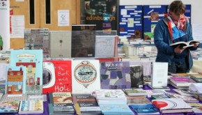 A display of books is browsed through at the Edinburgh Radical Book Fair event.