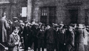 A large, worried crowd gathers outside the Army Drill Hall awaiting the news of local soldiers involved in the Quintinshill Rail Disaster near Gretna, 1915