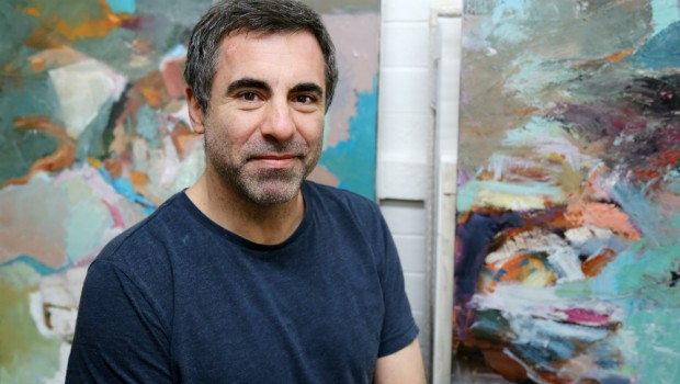 Trevor Jones in his studio displaying artwork