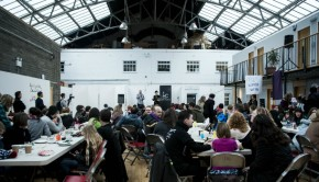 Large groups of people attend the Leith Late event at The Out of the Blue Drill Hall regarding art in Leith and Edinburgh.