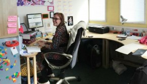 Creative writer Sian Bevan sits at her desk at Leith Walk Studios