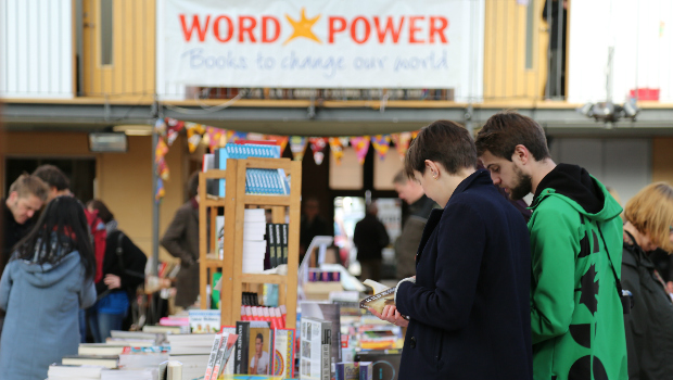 A group of customers browse a large selection of books at the Edinburgh Radical Book Fair