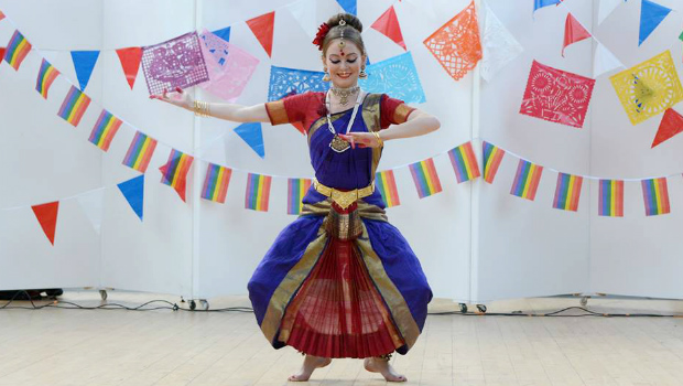 A woman performs a traditional Indian dance at the Wellbeing Mela event