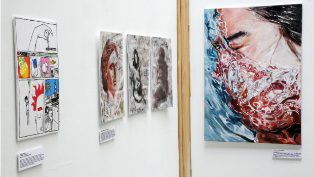 Various paintings and drawings on display in a visual arts exhibition