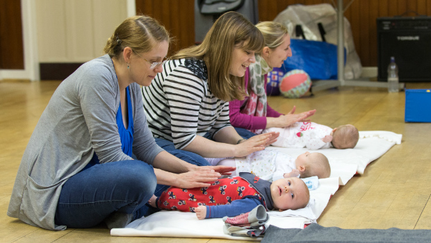 Three sets of parents with babies at a Sensory Session class.