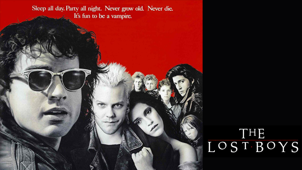 Poster for the film 'The Lost Boys' featuring a group of characters in front of a red background.