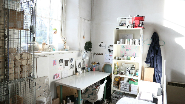 An artists' workspace at Abbeymount Studios with painted objects and the sun shining through the window overlooking Abbeyhill.