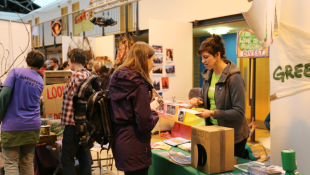 A stallholder chats to a customer about books at the Edinburgh Greenpeace Eco Fair