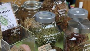 Pumpkin seeds, dried fruit and nuts in glass jars