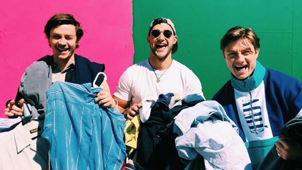 Vintage Kilo sale - young men holding clothes