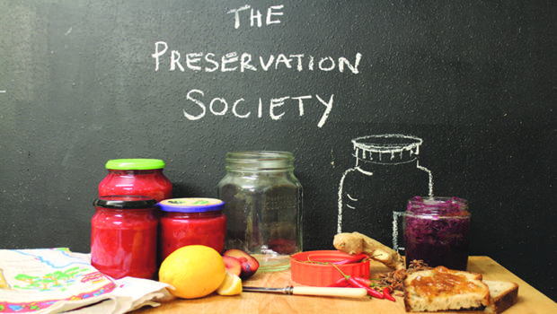 The Preservation Society logo depicting food and cutlery on a table
