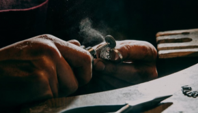 A jeweler making silver rings